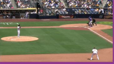Padres fan makes incredible foul ball catch while holding baby