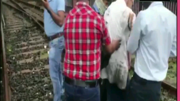 A man narrowly escaped death in Mumbai, India after the locomotive operator applied emergency brakes while the man was crossing the rail tracks