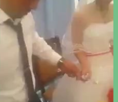 man slaps wifes hand, during their wedding, when she was playful with him