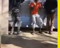 South African woman beating looters
