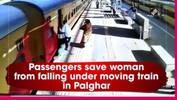 Woman slips trying to board moving train, Passengers rescue her