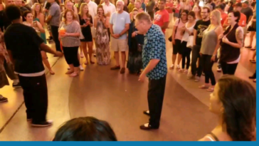 Older gentleman surprises younger dancer with his moves and the crowd cheers on.