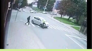 Some old man in Latvia almost killed another man with a car(this video was all over the news)